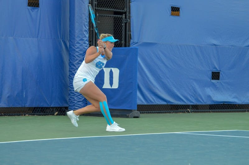 Sophomore Makenna Jones returns a serve against Duke on April 20 at the Ambler Tennis Center in Durham.