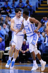 Juniors Luke Maye (32) and Kenny Williams (24) celebrate during the second half against Northern Iowa in an 86-69 victory on Nov. 10.