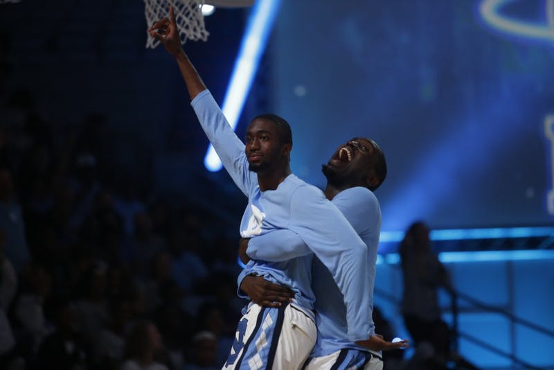 Brandon Robinson celebrates with Theo Pinson after hitting a shot during Late Night With Roy on Friday night.