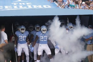 Senior Linebacker, Cayson Collins (23), stands at the mouth of the newly renovated players' tunnel as the Tar Heels prepare to take the field for a football game against Cal on Saturday, September 2, 2017.