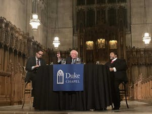 "Duke University Chapel hosted a ""public conversation"" with U.S. Sen. Bernie Sanders, D-VT, and the Rev. William Barber II moderated by Luke Powery Thursday. The three discussed race, poverty and militarism to commemorate Martin Luther King Jr."