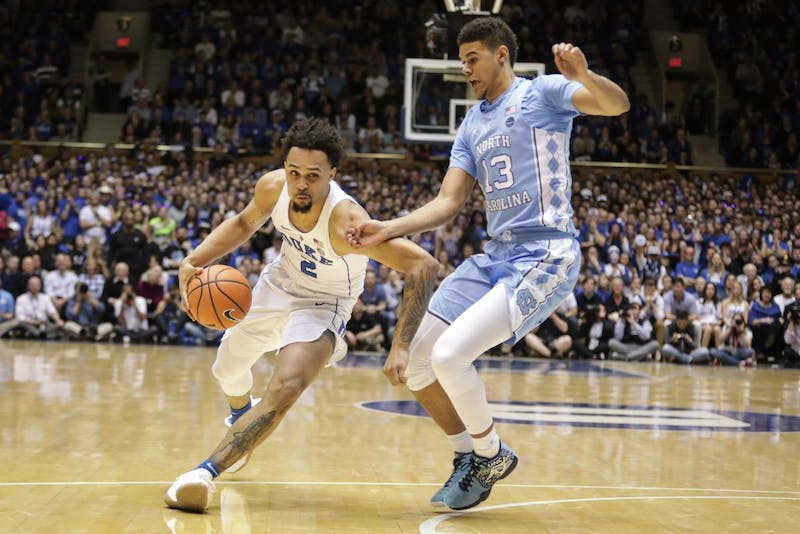Duke guard Gary Trent Jr. (2) drives the ball while North Carolina guard Cameron Johnson (13) defends on March 3 in Cameron Indoor Stadium.