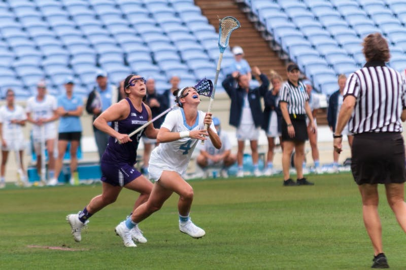 North Carolina women's lacrosse midfielder Marie McCool (4) reaches to catch the ball during Saturday's NCAA quarterfinal win against Northwestern.