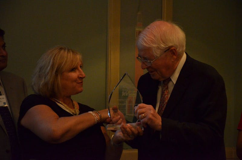 Executive Director of Cure HTT, Marianne S. Clancy, presents Congressman David Price an award on behalf of Cure HTT for his work in passing legislation on behalf of those affected by the genetic disease. Price, along with Gov. Roy Cooper, opposed the the proposed Republican health care bill.