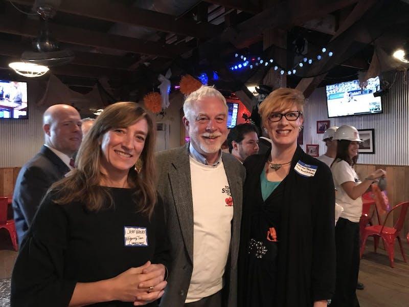 Commissioners Kathleen Ferguson, Jennifer Weaver, and mayor of the Town of Hillsborough, NC, Tom Stevens, pose at a Chamber of Commerce event. Photo courtesy of Tom Stevens.