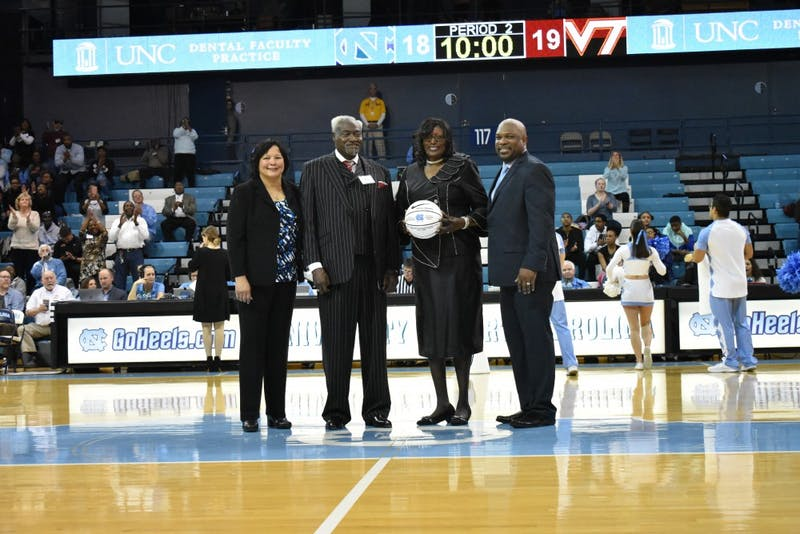 Tresa Brown (holding basketball) is honored during a Black History Month ceremony on Feb. 7 in Carmichael Arena.