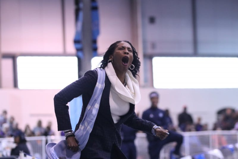 North Carolina track and field assistant coach Nicole Hudson celebrates Nicole Greene's NCAA-best 6-foot-2 high jump. The Tar Heels competed in the Dick Taylor Carolina Cup on Dec. 13 in Eddie Smith Field House.