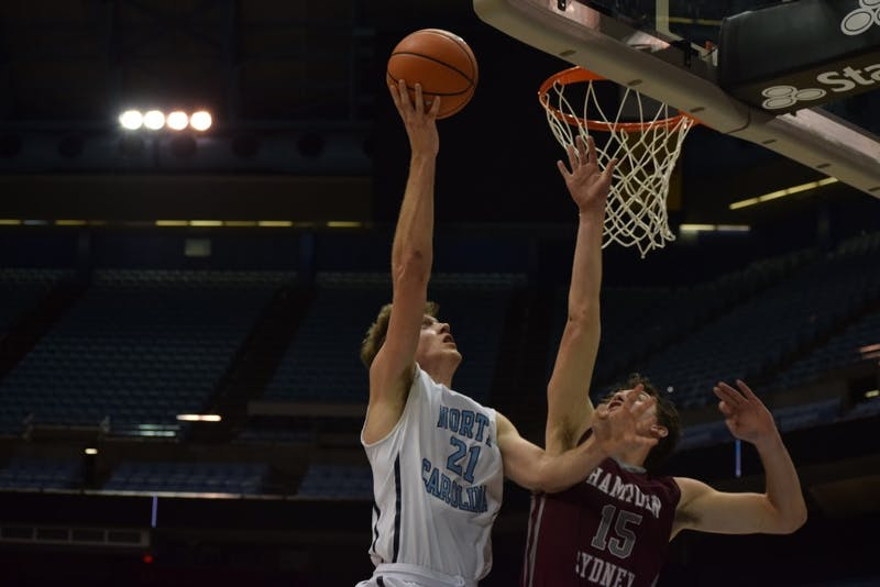 Vince Friedman (21) takes a layup against Hampden-Sydney College on Feb. 7 in the Smith Center.