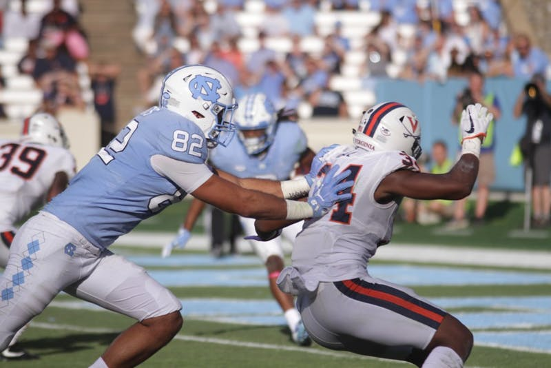 Tight end Brandon Fritts blocks a Virginia defender on Saturday.