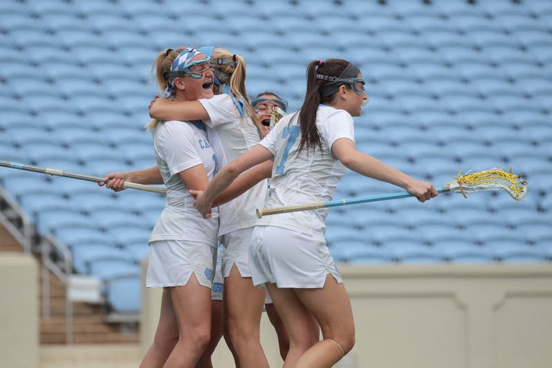 No. 8 UNC women's lacrosse celebrates a goal against no. 1 Maryland on Saturday, Feb. 24.