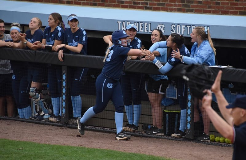 UNC softball team members celebrate after a play against UNC-G on Wednesday in Anderson Stadium.
