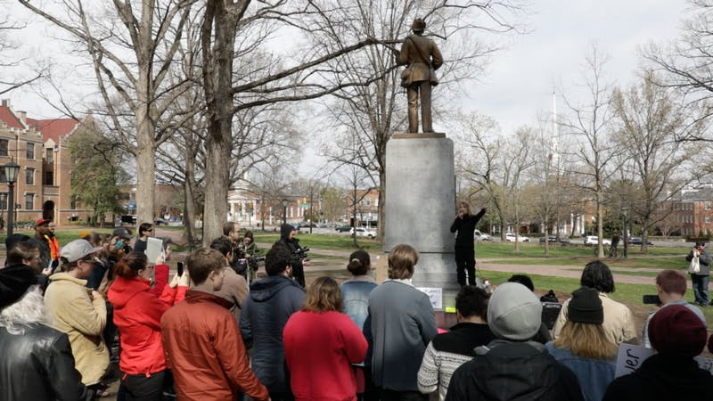 Chelsea Manning gives a speech in front of the Silent Sam monument during a rally on Saturday afternoon.