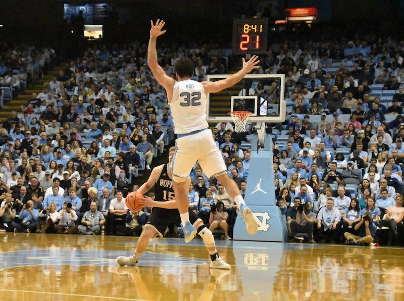 North Carolina forward Luke Maye (32) defends Wofford guard Trevor Stumpe (15) during a Dec. 21 game in the Smith Center.