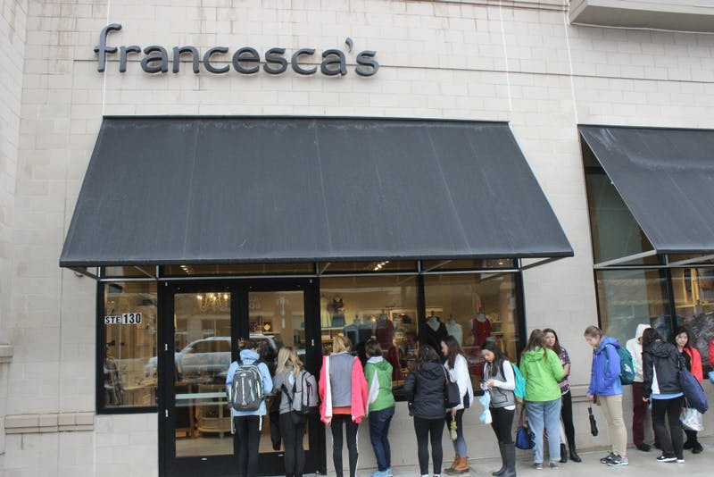 People gather outside of Francesca's early Saturday, Feb. 10, for its grand opening.
