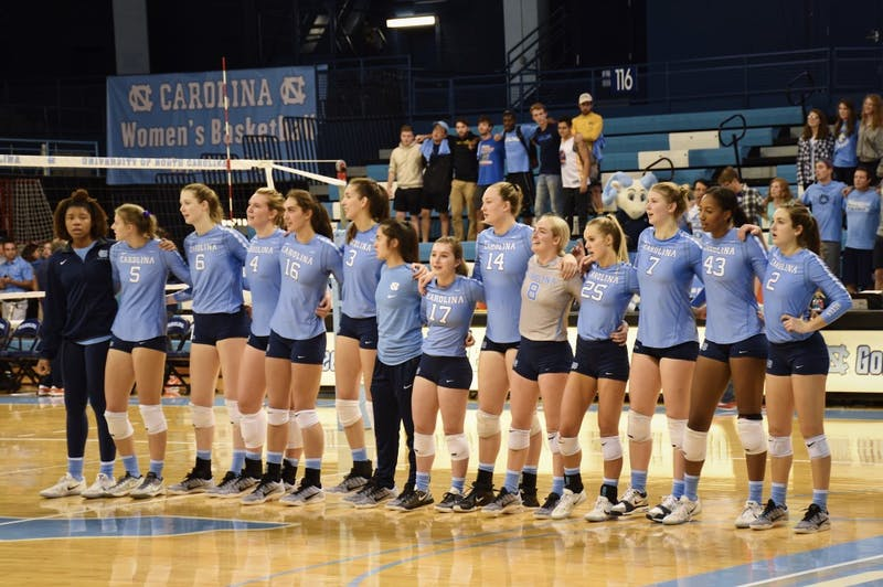 The North Carolina volleyball team sings its alma mater after a 3-0 win over Syracuse on Sunday afternoon in Carmichael Arena.