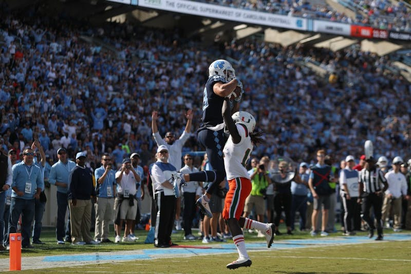 Wide receiver Beau Corrales (88) elevates for a touchdown against Miami on Saturday in Kenan Stadium.