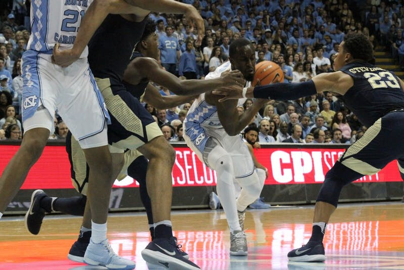 Theo Pinson (1) drives toward the basket against Pittsburgh on Feb. 3 in the Smith Center.