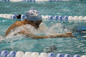 UNC's Meghan Dupay competes during Saturday's home meet at Koury Natatorium. Both the men's and women's teams beat Penn State and Navy.