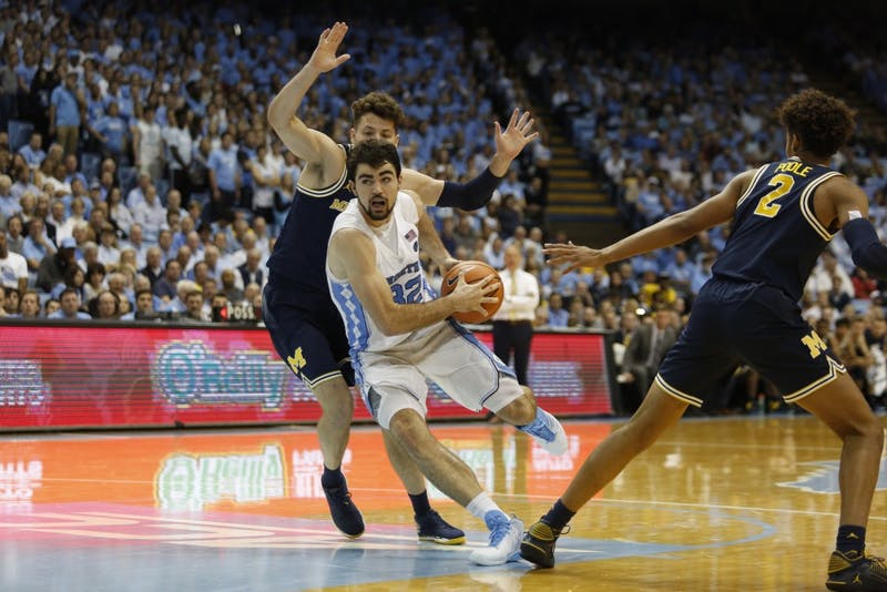 North Carolina forward Luke Maye (32) drives toward the basket against Michigan in the Smith Center.