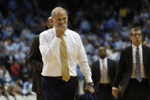 Michigan men's basketball head coach John Beilein walks off the court after the first half of a game against North Carolina on Nov. 29 in the Smith Center.