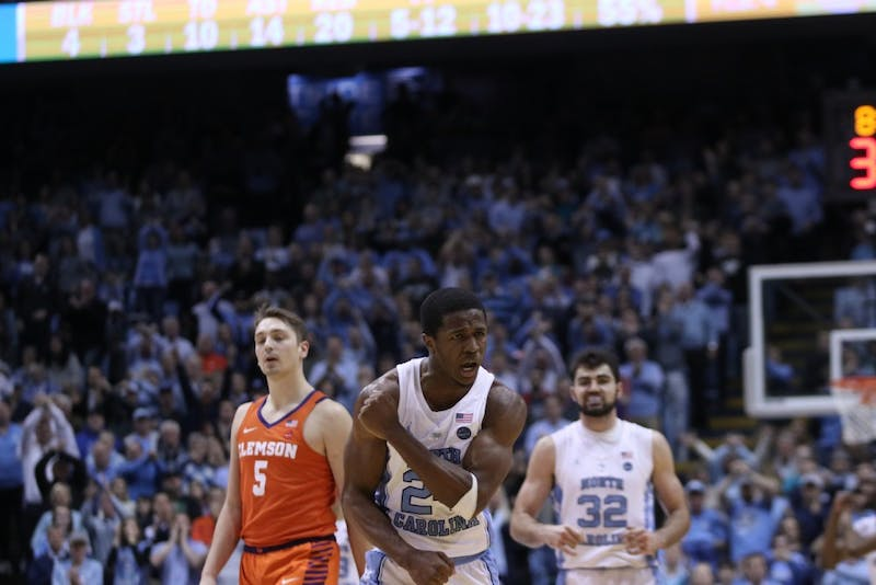 Guard Kenny Williams (24) celebrates near the end of a Jan. 16 game against Clemson in the Smith Center.