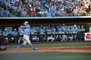 Ashton McGee (36) swings during a home game against Davidson at Boshamer Stadium.