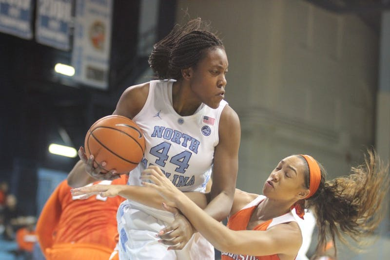 Forward Janelle Bailey (44) snags a rebound during Thursday night's game against Clemson in Carmichael Arena.