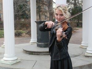 Waverly Leonard plays the fiddle in the Carolina Bluegrass Band.