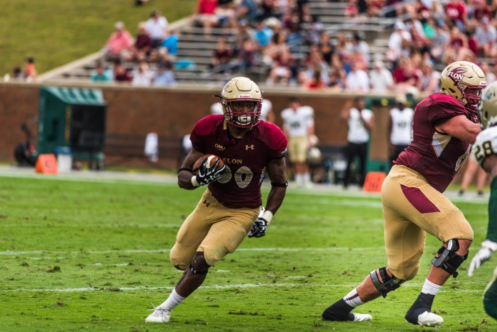 Junior running back Malcolm Summers rushes against the William & Mary defense on Oct. 7.