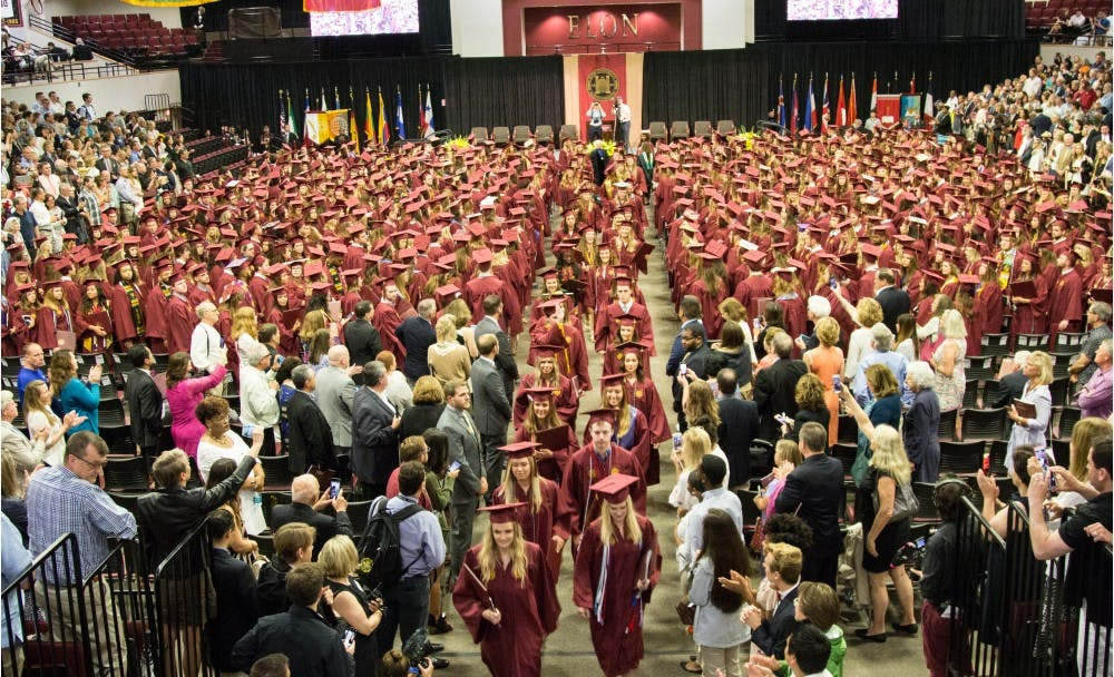 Now alumni, the first graduates from the Class of 2018 file out of Alumni Gym following the end of Elon's first 128th Commencement, May 19.