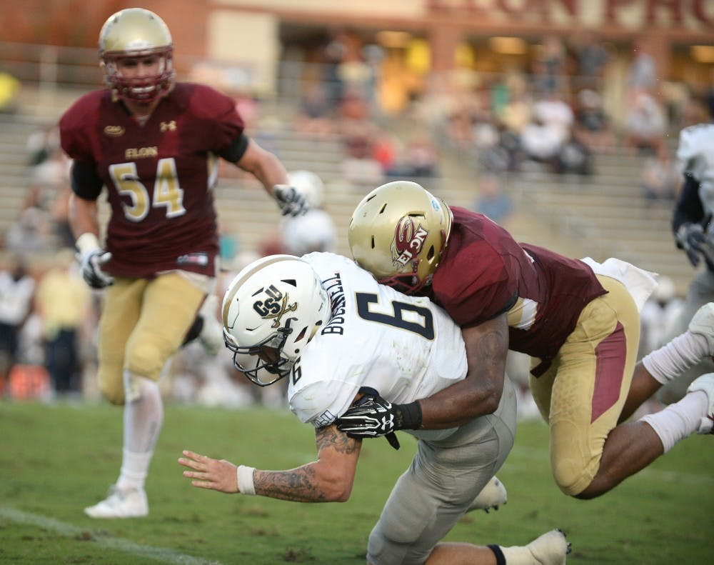 Defensive back Chris Blair tackles Charleston Southern's Shane Bucenell during Elon's football game at Rhodes Stadium on Sept. 16.