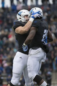 GVL / Luke Holmes - Nick Keizer (41) celebrates with Marty Carter (21) after scoring. GVSU lost to Ferris State in Lubbers Stadium on Saturday, Dec. 3, 2016.