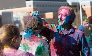 GVL / Kevin Sielaff - Assistant Professor of Liberal Studies Brent Smith participates in Holi. Grand Valley celebrates India's spring color festival, Holi, for the first time on Friday, April 15, 2016.