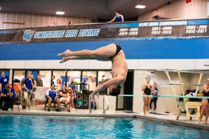GVL / Matt Read. The GVSU Swim Team Participating in a meet on Saturday, January 13th @ the Recreation Center.