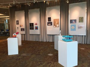 """""""Biotechnology Through the Artist's Lens"""" fills the exhibition space within the Mary Idema Pew Library Courtesy / Agnieszka Szarecka"""