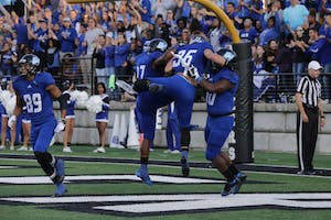 GVL / Emily Frye - Defensive back Eric Plate celebrates GVSU's first touchdown of the game with his teammates Saturday, Sept. 9, 2017. Plate blocked Davenport's punt, allowing Luke DeLong to recover the ball in the end zone for a Laker touchdown.