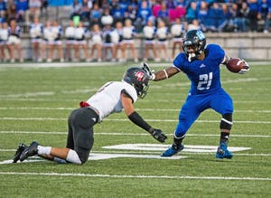 GVL / Spencer ScarberMarty Carter deflects the tackle during the game against Davenport on Saturday September 9, 2017.