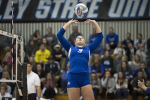 GVL / Luke Holmes - Katie Olson (9) sets the ball. GVSU volleyball defeated Northwood in three games in the Fieldhouse Arena on Friday, Nov. 11, 2016.