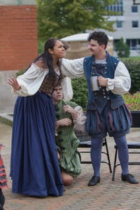 GVL/Mackenzie Bush - Actors hold a skit at the Carillon Tower to show what life was like in the 1500s at the Renaissanec Festival on Saturday, Oct. 1, 2016.