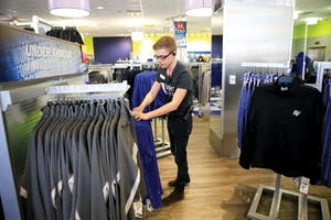 GVL / Emily Frye - Christopher Stark works within the Laker Store on Wendesday, April 15, 2015.