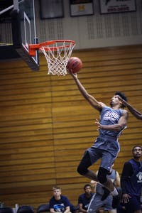 GVL/ Sheila Babbitt Justin Greason goes in for a layup during the scrimmage against Macomb on Sunday October 22, 2017