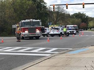 GVL / Emily Doran Emergency responders assist an injured pedestrian after a motor vehicle crash on GVSU's Allendale Campus Thursday, Sept. 28.