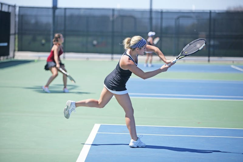 GVL / Emily FryeJunior Abby Perkins hits the serve during a spring match on April 17, 2016.