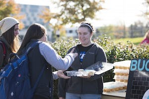 GVL / Luke Holmes - Kimberly Long passes out cupcakes. GVSU Founders Day was celebrated on Tuesday, Oct. 25, 2016 next to the clock tower.