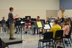A high school student conducts his fellow campers at GVSU's Servant Leadership in Music camp on June 20. Courtesy / Caitlin Cusack