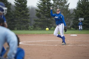 GVL / Luke Holmes - Allison Lipovsky (18) throws the pitch. Grand Valley Women's Softball won 9-5 in their first game against Lake Superior State.
