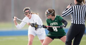 GVL / Kevin Sielaff – Meghan Datema (18) takes a face-off at mid-field. The Lakers take the victory over Tiffin University Friday, April 1, 2016.