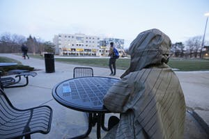 GVL / Emily Frye   GVSU student sits alone outside of Kirkhof center on Wednesday January 24, 2018.