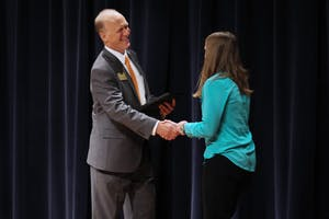 GVL / Sheila BabbittJeffrey Potteiger, Dean of the Graduate School, presents the awards at the Graduate Showcase on April 10th, 2018.