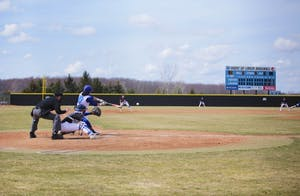 GVL / Emily Frye Zach Berry gets a hit during GVSU's game against Hillsdale on Tuesday, April 10th, 2018.